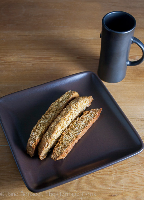 cookies on square plate with mug of coffee;Oatmeal Coconut Biscotti (Gluten Free) © 2019 Jane Bonacci, The Heritage Cook