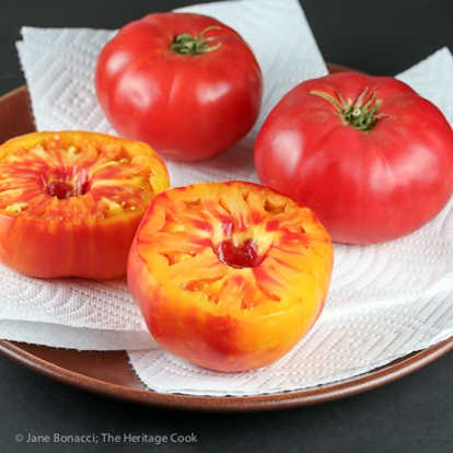 Whole & halved heirloom tomatoes; Roasted Rice-Stuffed Tomatoes © 2019 Jane Bonacci, The Heritage Cook