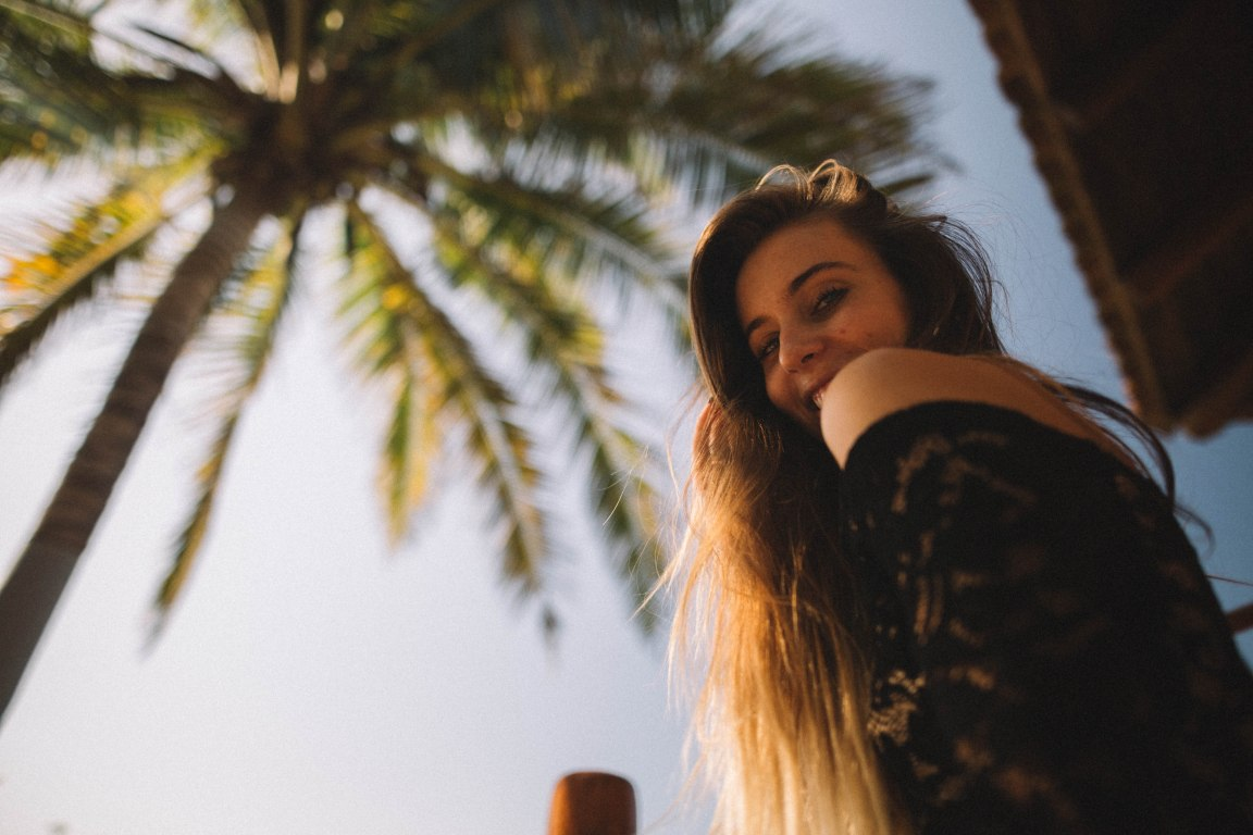 influencers losing influence girl at beach palm tree
