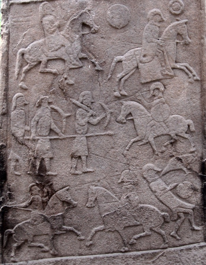 Pictish stone in the churchyard at Aberlemno Parish Church (the stone is sometimes known as Aberlemno II). The battle scene depicted is generally accepted to be that of the Battle of Nechtansmere. [Public Domain] via Creative Commons.jpg