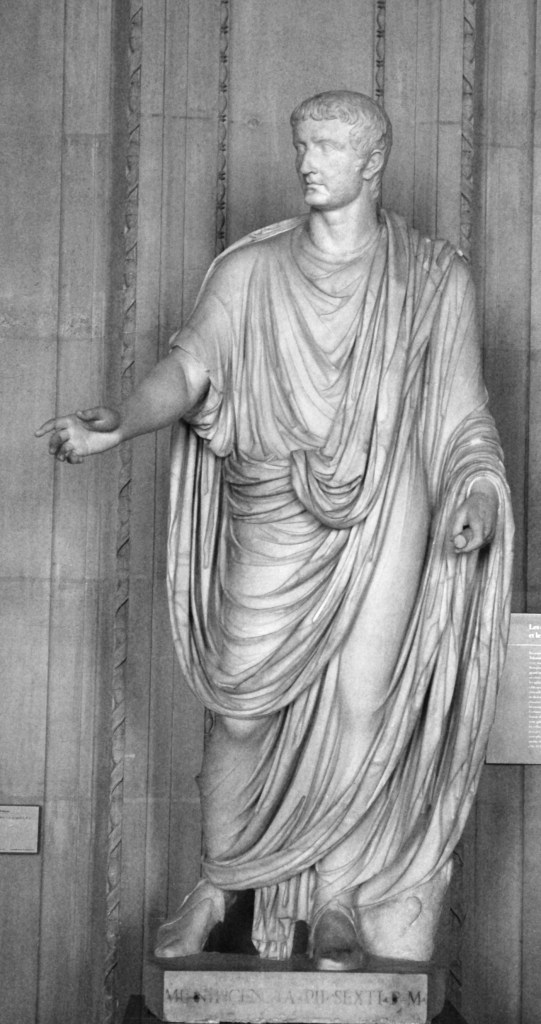 1st centiry statue of Emperor Tiberius, c. 1st century, held within the Louvre Museum, [Public Domain] via Creative Commons