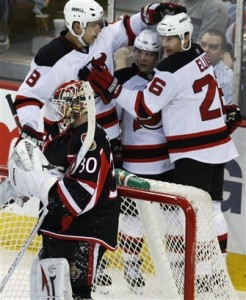 Brian Gionta (center) recorded 152 and 160 assists over the course of 473 games for the New Jersey Devils from 2001-2009. (AP Photo/The Canadian Press)