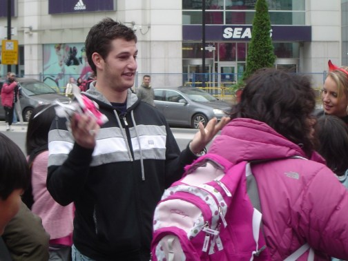 Darryl Boyce indicates to a group of sweet-toothed students that he is out of candy at Toronto's Yonge & Dundas Square.