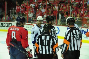 Referee discussions are common when calling the puck over glass penalty. (Tom Turk/THW)