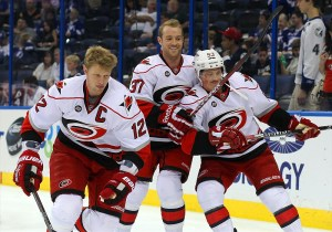 Eric Staal (12), Tim Brent (37) and Jeff Skinner Hurricanes