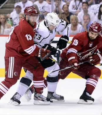 Dustin Brown battles Ray Whitney