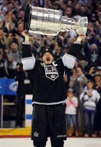 Dustin Brown hoisted the Cup high overhead in June, but is one of the Kings seemingly under a cloud so far this year. (Jayne Kamin-Oncea-US PRESSWIRE)
