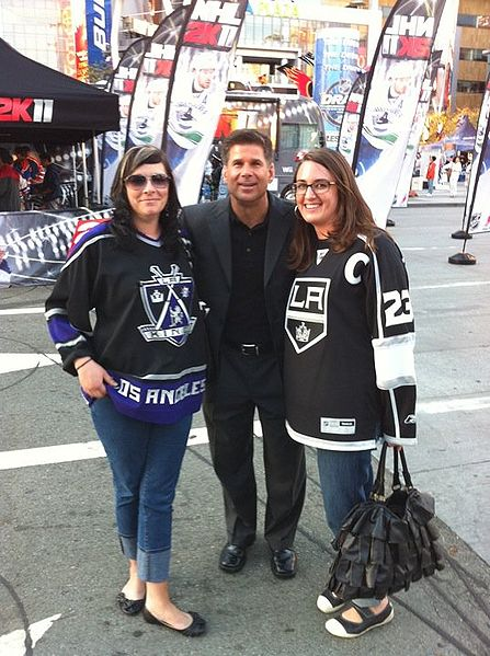 Fox, with two Kings fans in front of L.A. Live in Los Angeles. Credit: Harburrito (Own work) via Wikimedia Commons