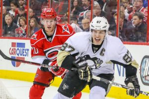 Pittsburgh Penguin SIDNEY CROSBY and Carolina Hurricane RILEY NASH - Photo by Andy Martin Jr