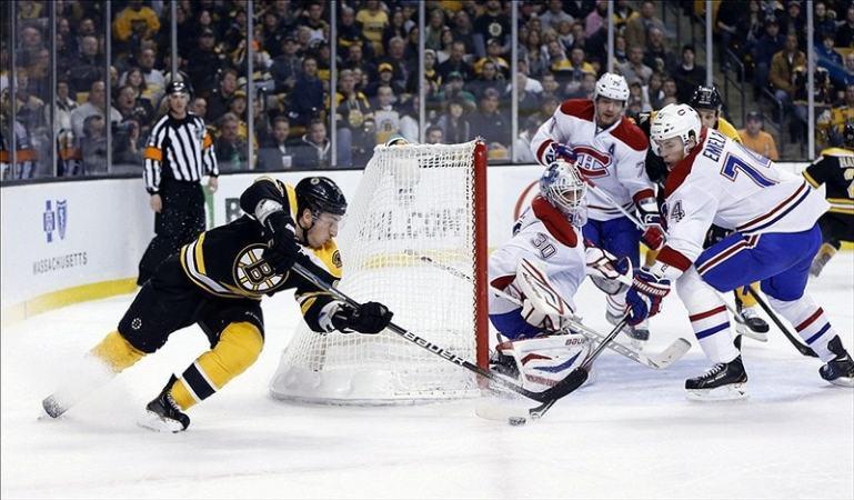 Brad Marchand defended by Montreal Canadiens defenseman Alexei Emelin