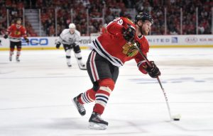 Bryan Bickell takes a shot during a game last season (Rob Grabowski-USA TODAY Sports)