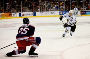 Dmitry Orlov fires a shot in an AHL game against the Hartford Wold Pack (Annie Erling Gofus/The Hockey Writers)