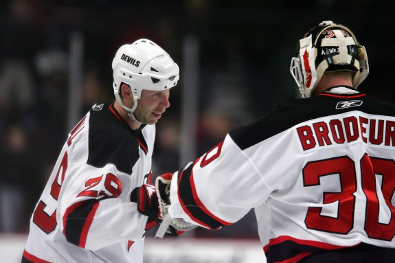 Grant Marshall celebrates a win with Martin Brodeur. (Jerry Lai-USA TODAY Sports)