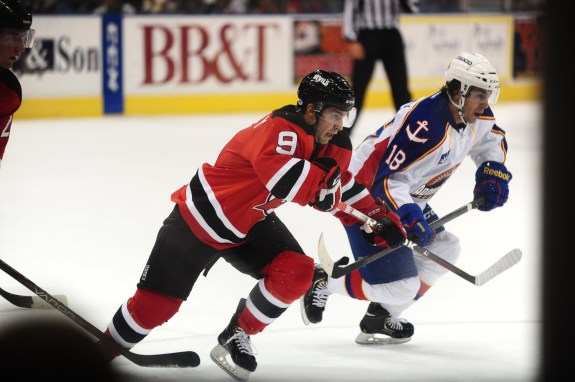 Steven (18) playing against his older brother Joe (9) Photo Credit: (Norfolk Admirals/John Wright)