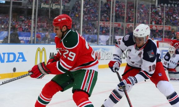 Ryane Clowe tries to make a play on the puck as Marc Staal pursues him. (Ed Mulholland-USA TODAY Sports)