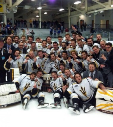 Players from the Arizona State University hockey team (Tempe,Arizona) pose with the National Championship Trophy