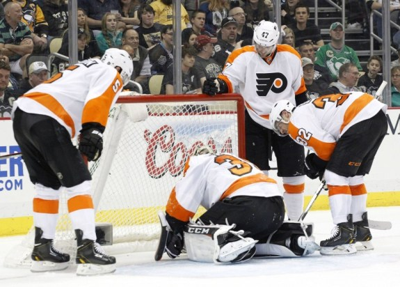 Steve Mason suffered a concussion after Jayson Megna shoved Andrew MacDonald into him in Philadelphia's 4-3 overtime win on Saturday.
