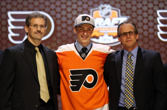 Despite a slew of organizational obstacles, Ron Hextall (left) is building an early case for next year's GM of the Year award.