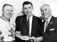 Buddy Boone, Max McNab, GM, and Fred Hume, President of the Vancouver Canucks