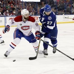 Montreal Canadiens defenseman Greg Pateryn and Tampa Bay Lightning forward Jonathan Drouin