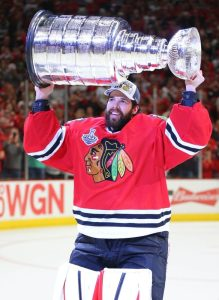 Corey Crawford hoists the Cup with the winning playoff beard intact (Dennis Wierzbicki-USA TODAY Sports)