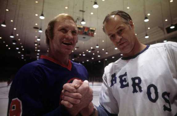 Bobby Hull #9 of the Winnipeg Jets and Gordie Howe #9 of the Houston Aeros