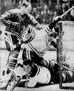 Ed Johnston stops Hawks' Doug Mohns while Forbes Kennedy lends a hand.