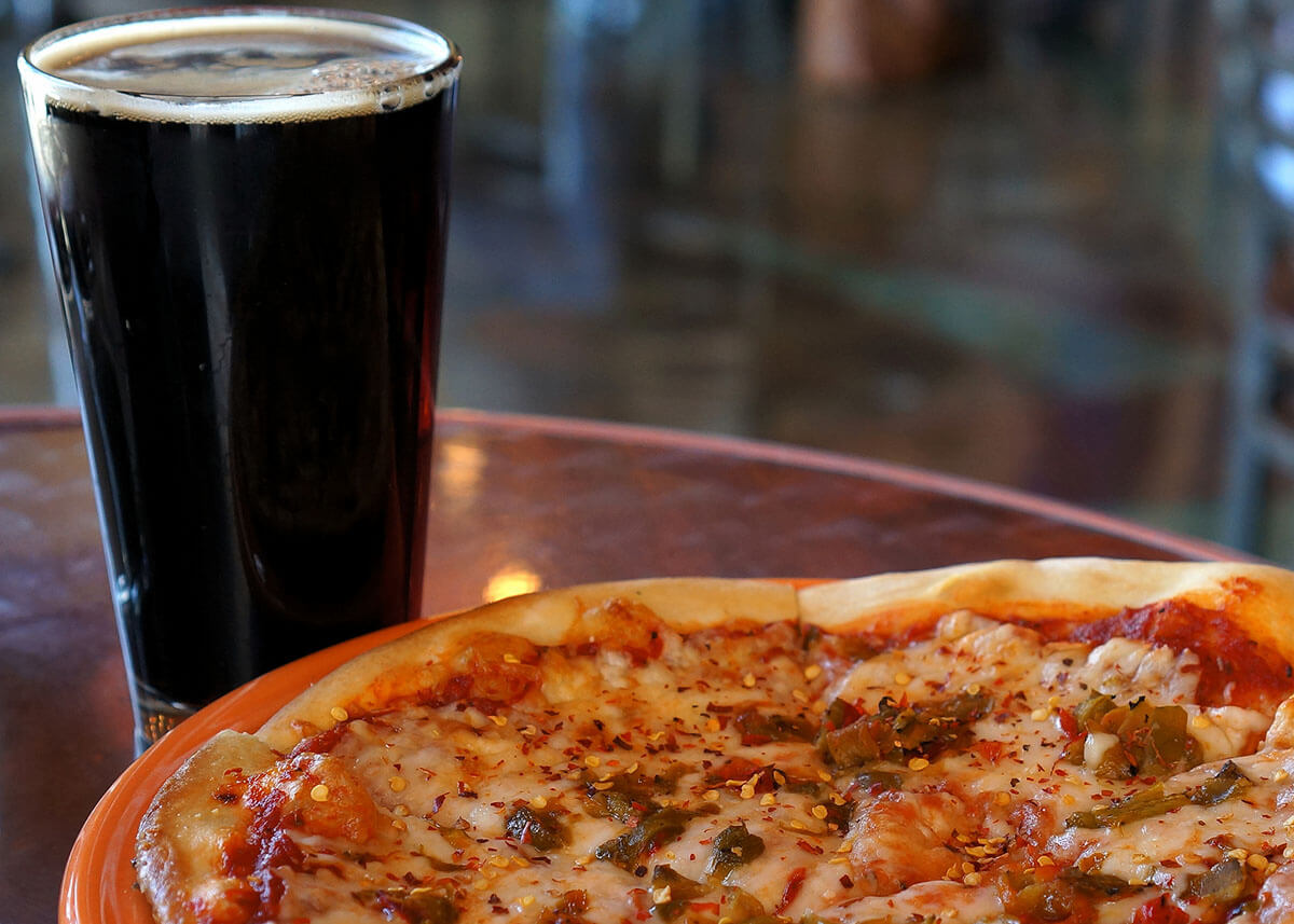 Enjoying pizza and craft beer in an offbeat Corpus Christi restaurant