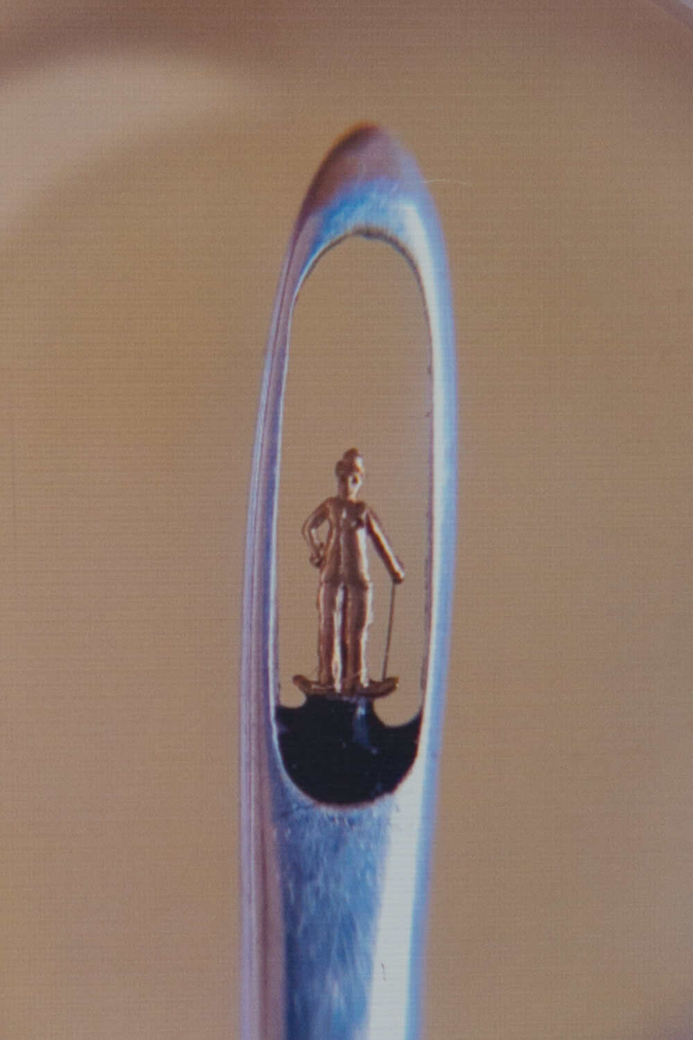 The world's smallest statue of Charlie Chaplin is made of gold, fits in the eye of a needle, and on display at Ter-Ghazaryans' Micro Art Museum in Yerevan, Armenia
