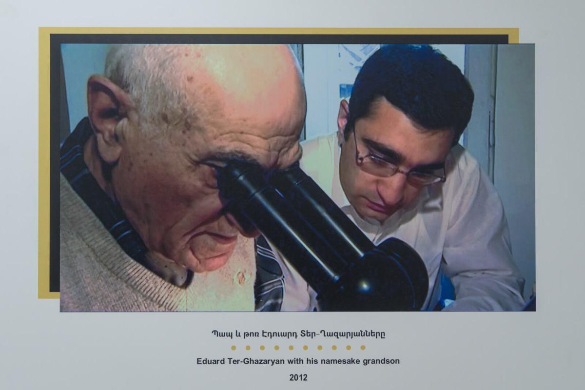 Eduard Ter-Ghazaryan teaching his grandson the secret techniques to creating micro artworks.