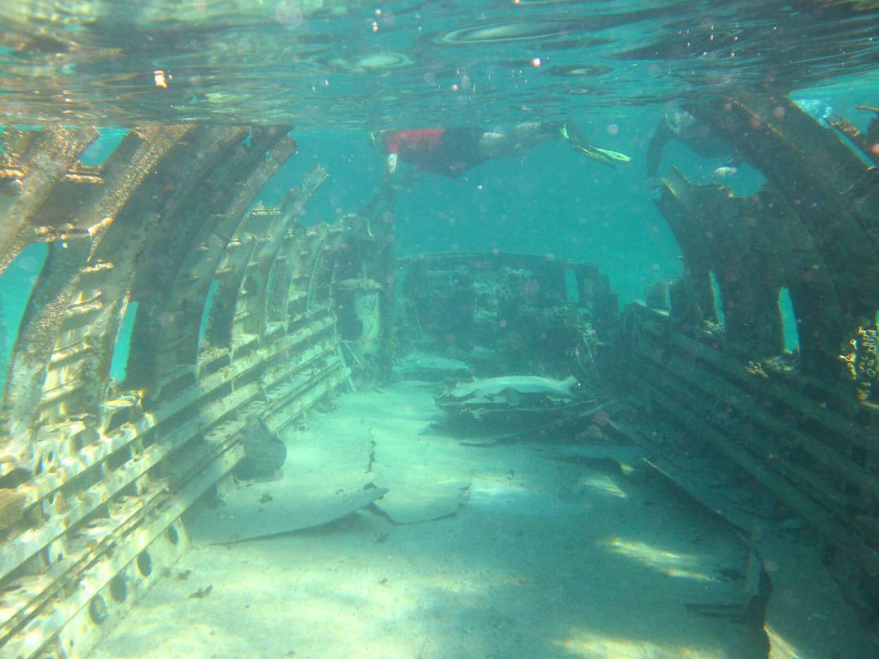 Swimming around an underwater airplane wreck in the Bahamas
