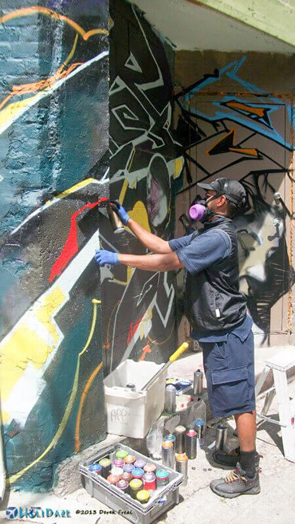 Graffiti artist at work in Kensington Market, Toronto, Canada