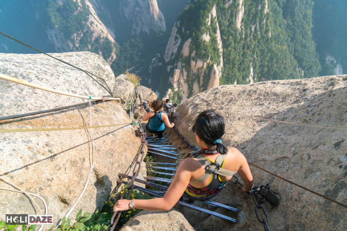 Climbing down the vertical stretch of Huashan, the deadliest hiking trail in the world -- because here there is no trail!