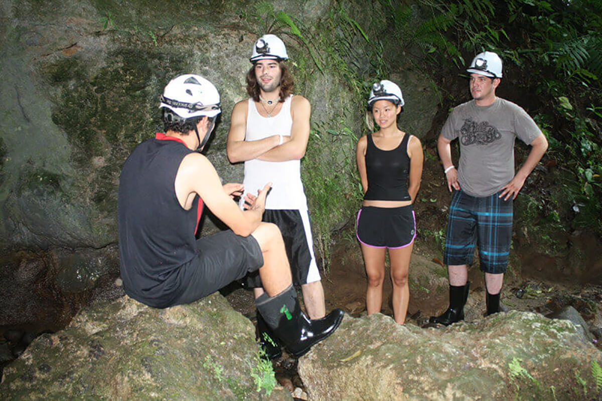 Speaking with our tour guide before entering the Venado Caves of La Fortuna, Costa Rica