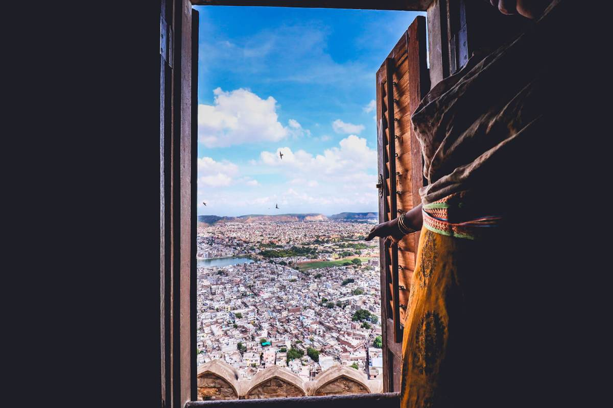 Inside of Nahargarh Fort peering out at the city of Jaipur down below