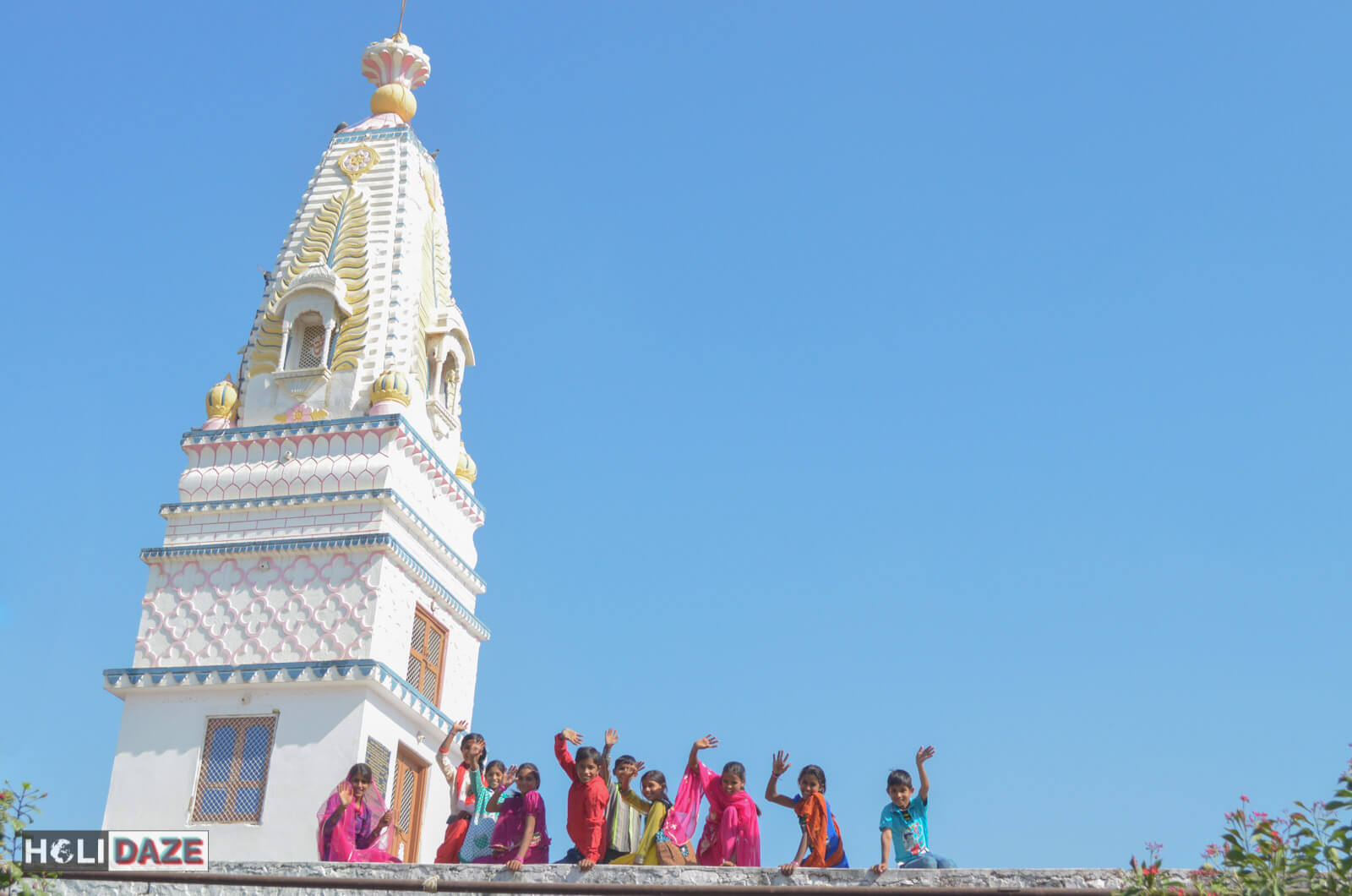 Young kids standing on top of a temple in Pushkar led us to one of my favorite temples of all time!