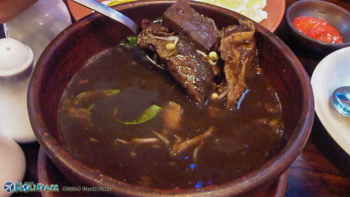 Eating Rawon in Surabaya, one of the most delicious regional delicacies of Indonesia