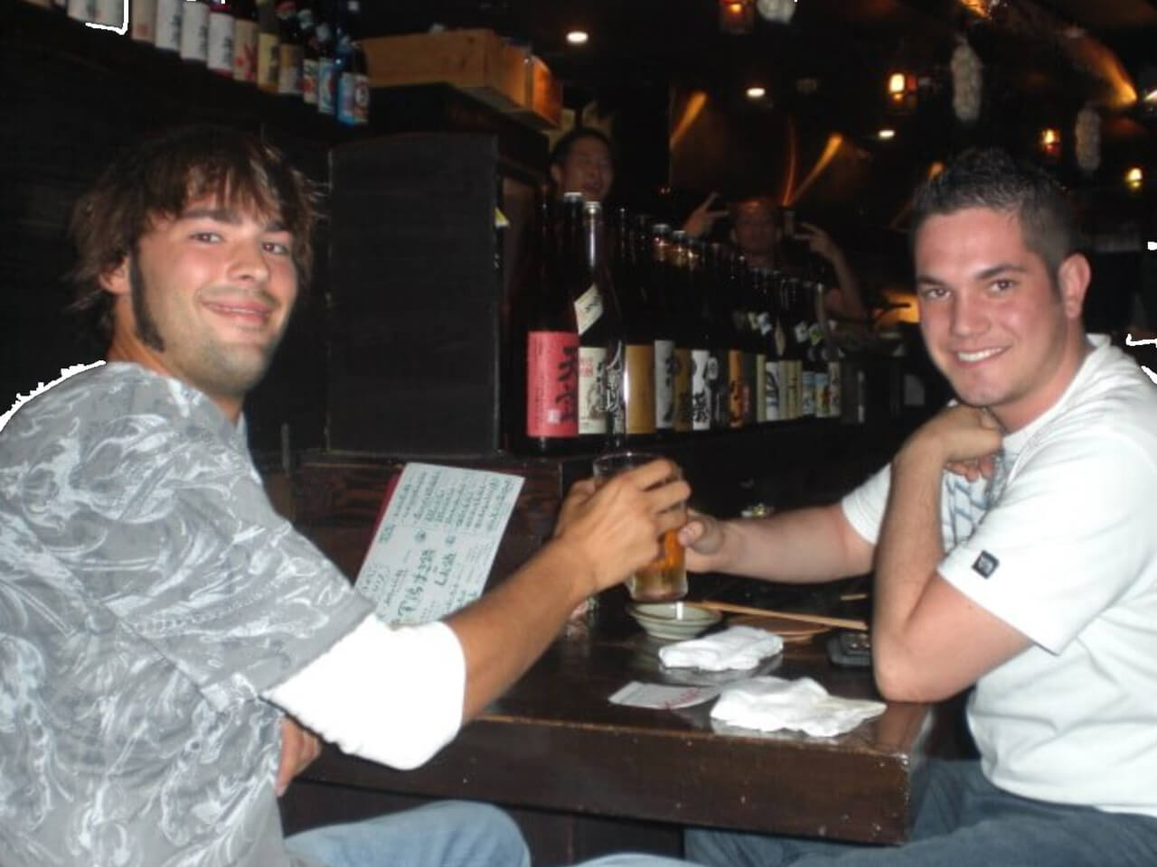Drinking and eating sashimi at a restaurant in Shibuya, Tokyo