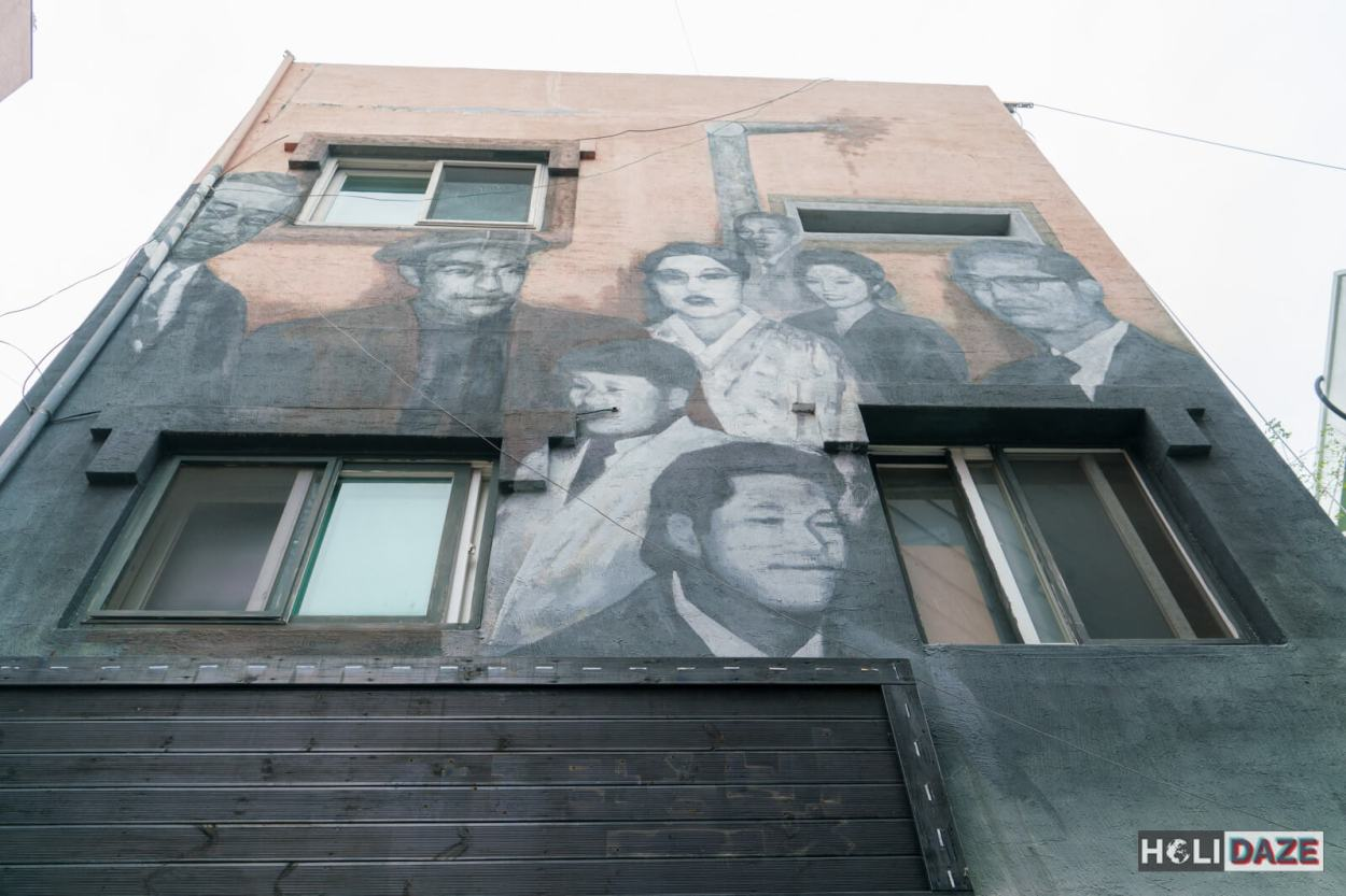 Three story urban art mural on the side of a building in Changdong Art Village, Masan, South Korea