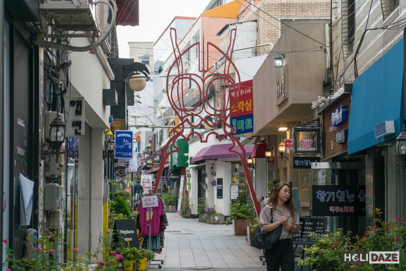 The iconic red alien at the entrance of Chang-dong Art Village