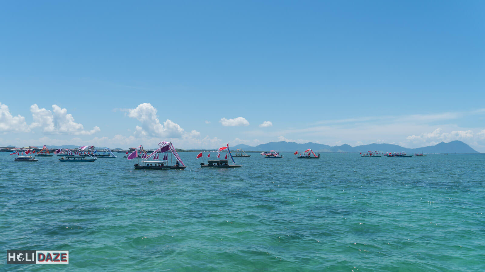 Boats arriving for the Regatta Lepa festival in Semporna, Sabah