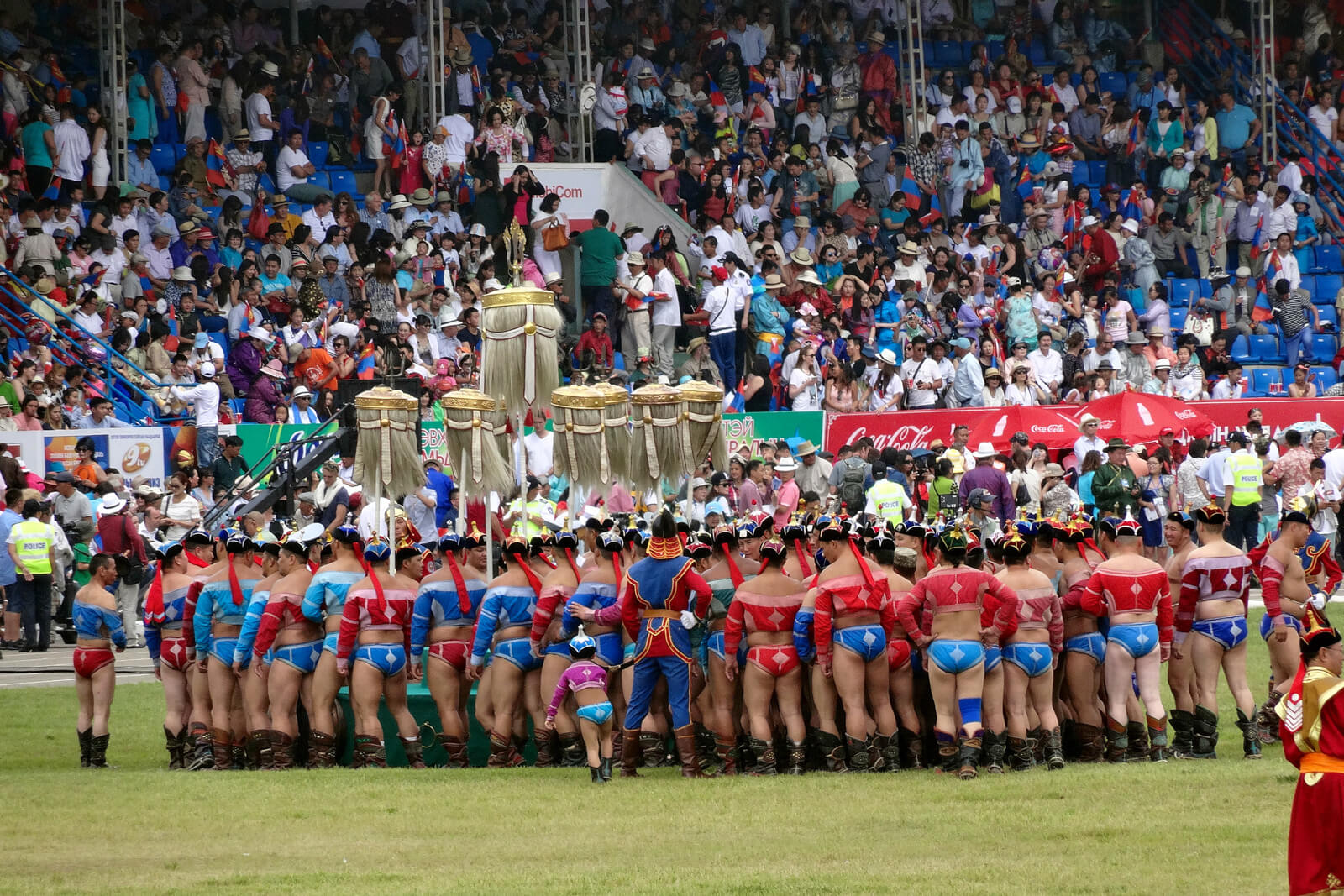 Wrestlers gathering at the Naadam festival opening ceremony in Ulaanbaatar, Mongolia, at the National Sports Stadium