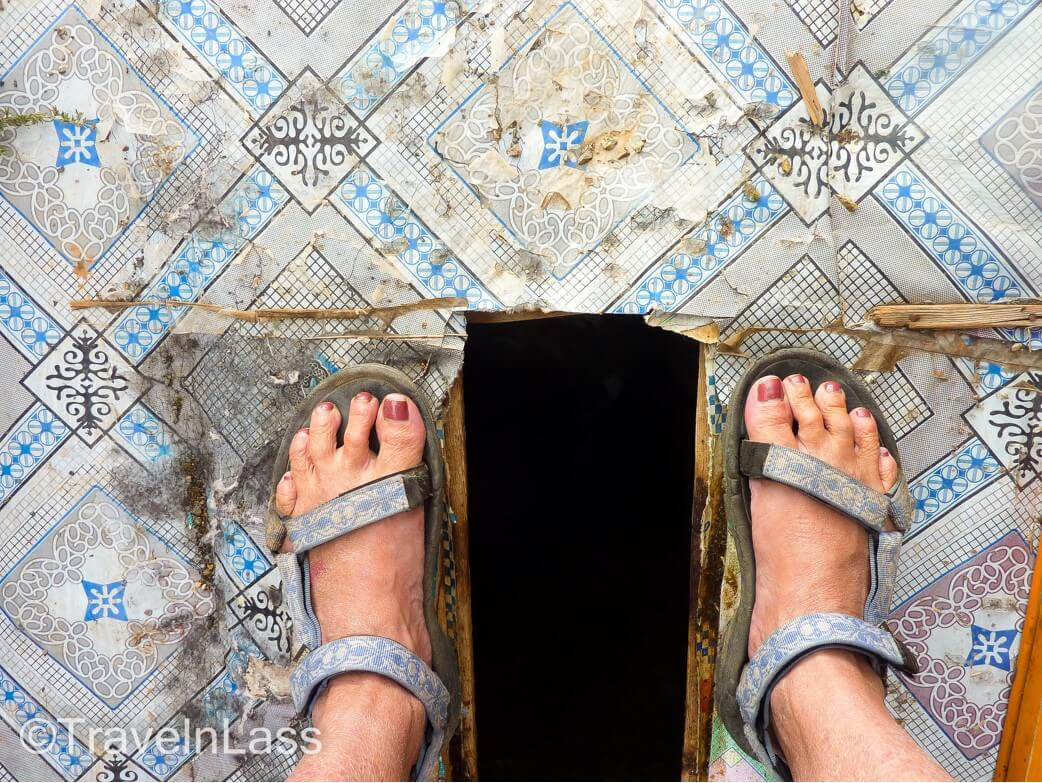 Squat toilet in Mongolia. Dealing with things like this is how travel ruins your life.