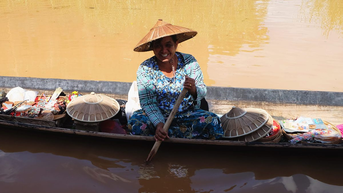 Local lady selling souvenirs out of her boat at Inle Lake, Myanmar