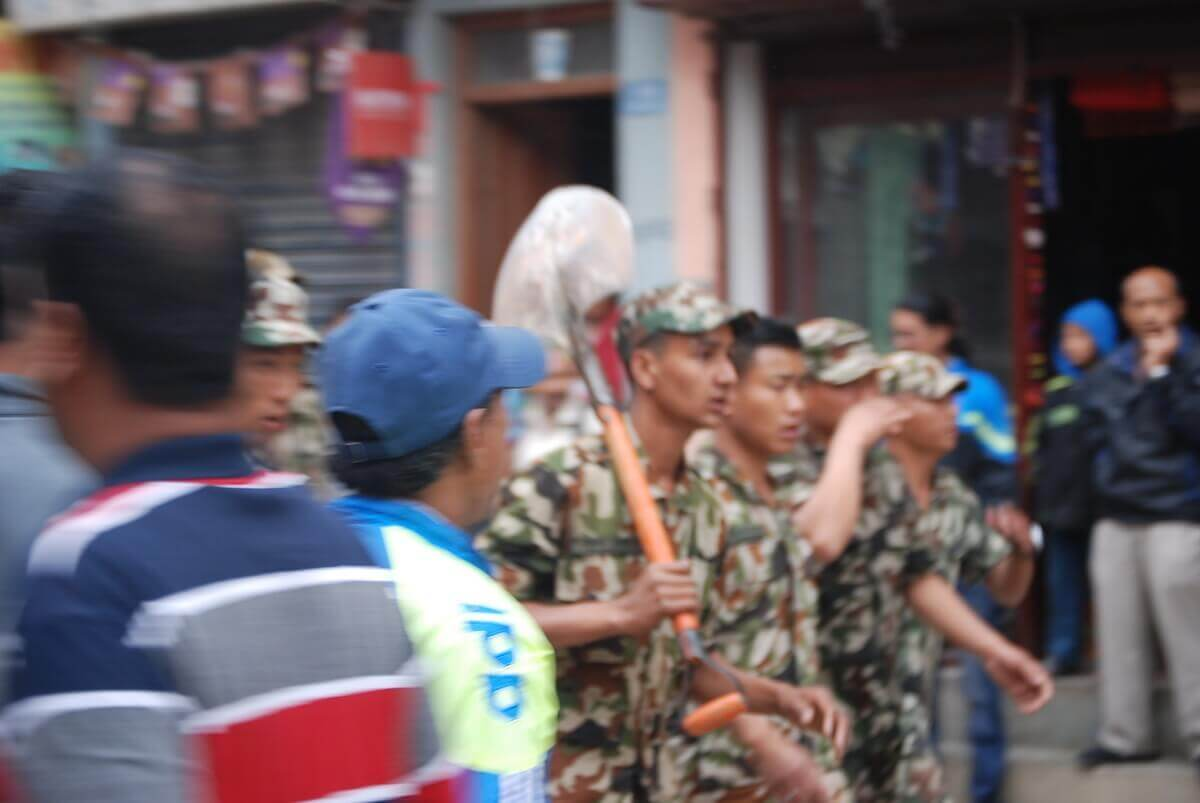 Within hours the military had arrived with shovels and other tools to help rescue people trapped in the rubble. Photo by my quake buddy David Stone.