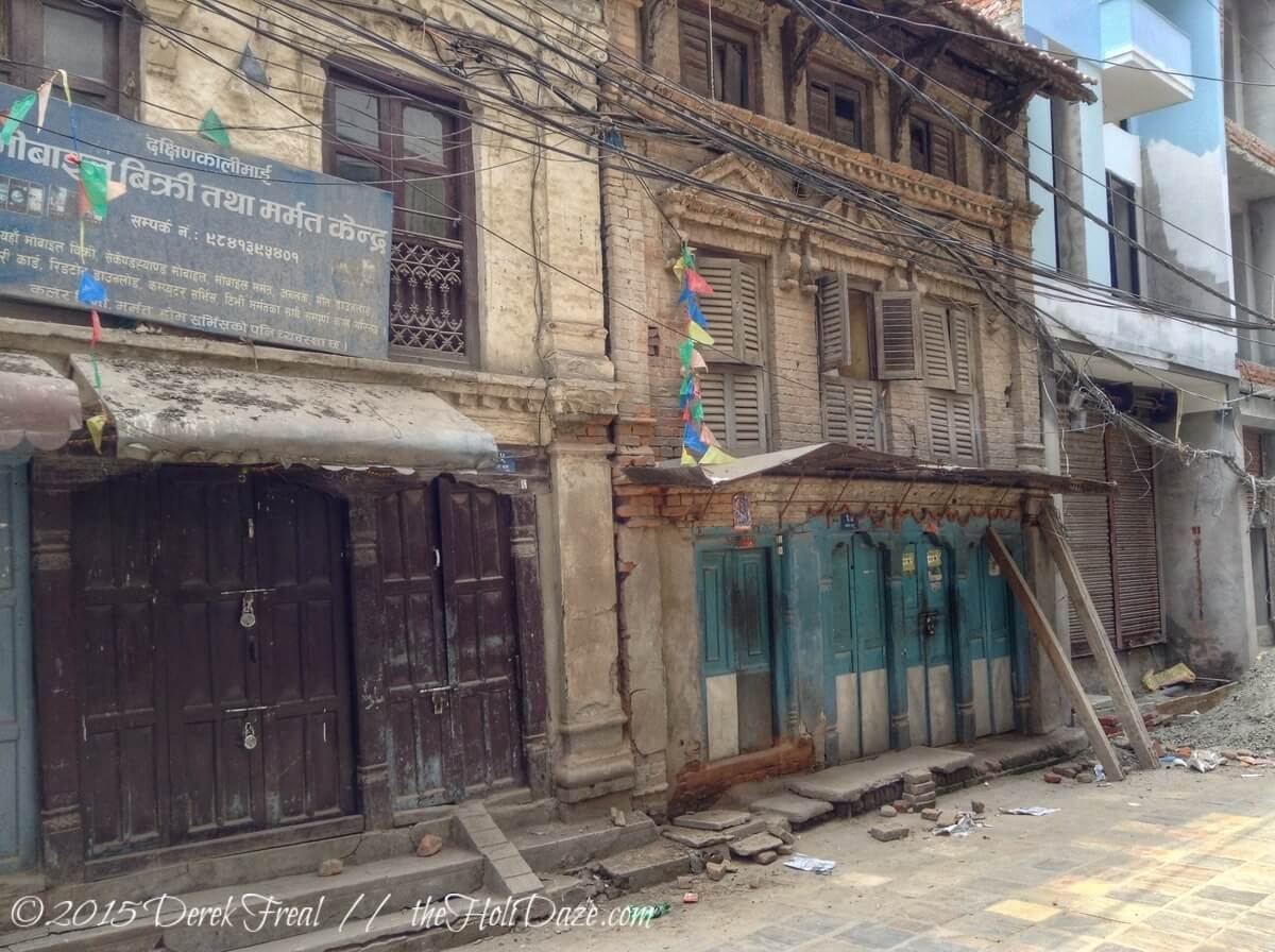 Kathmandu after the earthquake. I am quite convinced those two wooden supports are holding this entire structure up.