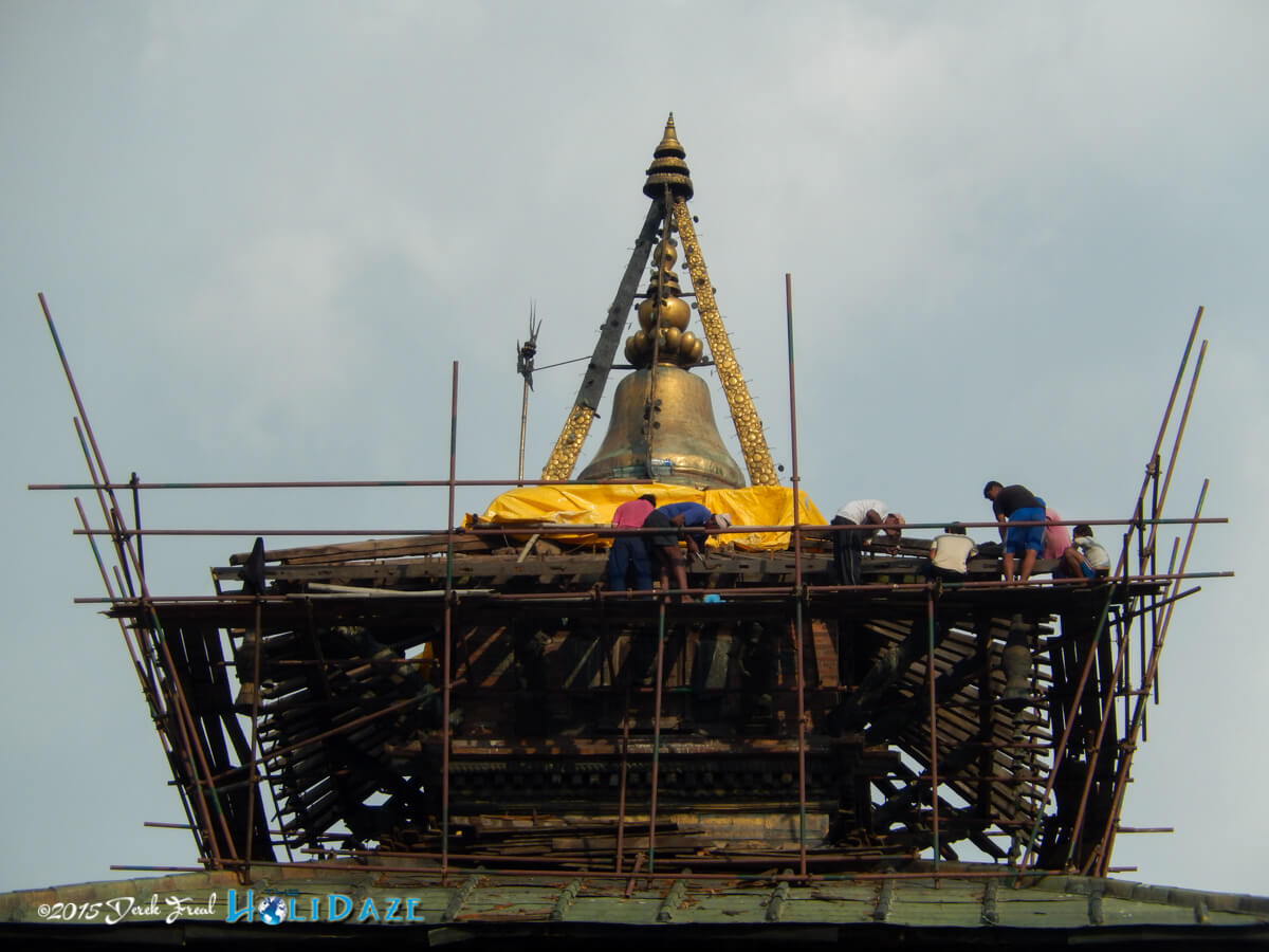 Earthquake repair work is still ongoing in Kathmandu, even in the middle of the Indra Jatra festival