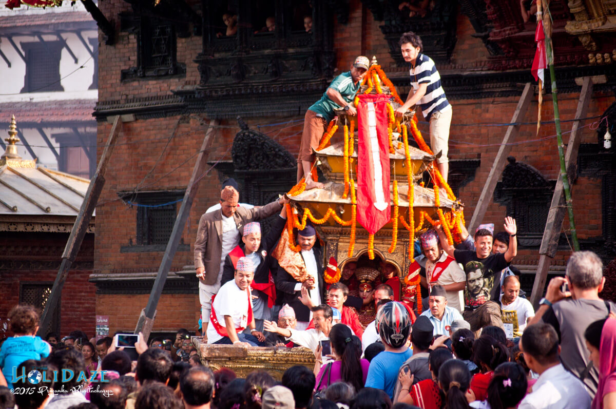 The Royal Kumari of Nepal on her golden chariot at the Indra Jatra festival 2015