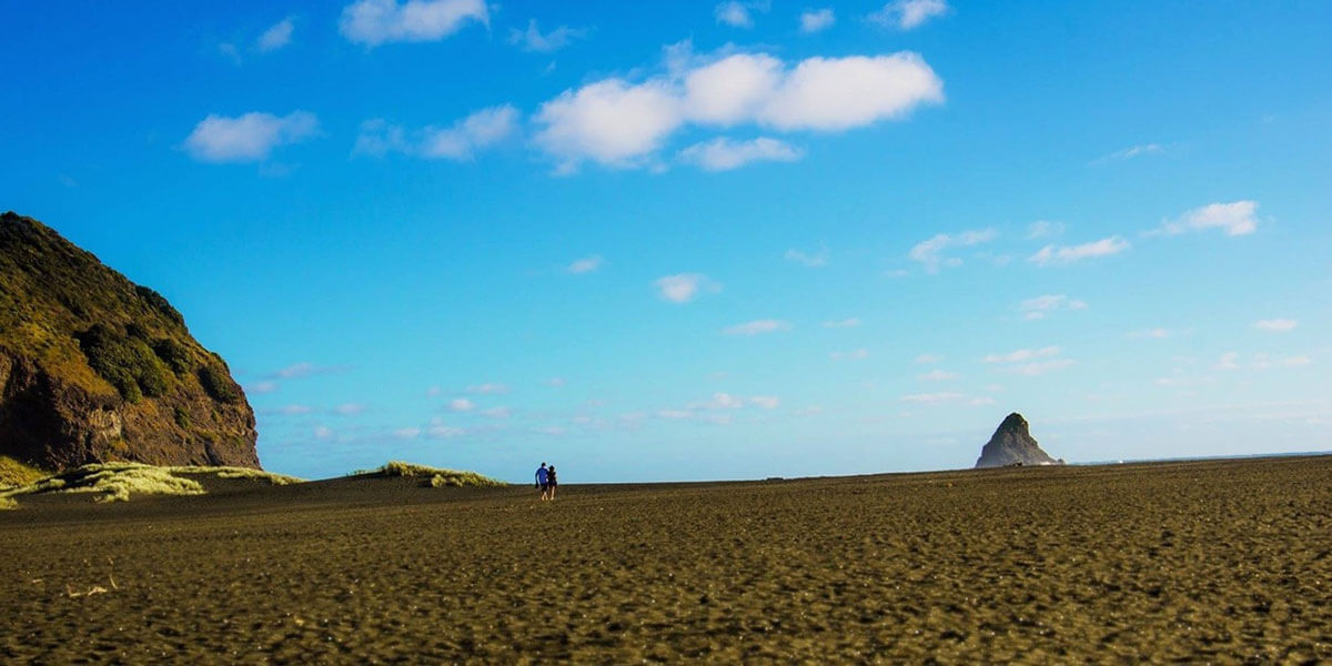Does your Auckland travel guide mention Karekare Beach?
