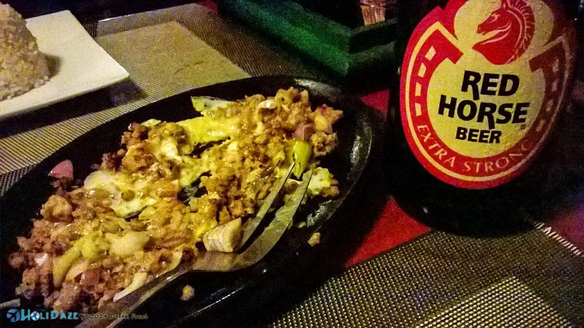 Crocodile sisig served with rice and Red Horse -- a meal fit for a king. Coron Island, Palawan, Philippines